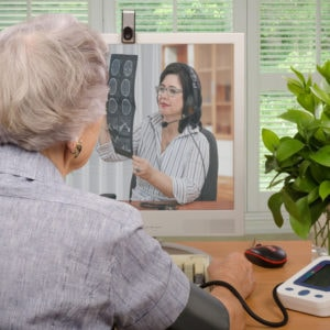 Patient talks to a doctor on a computer screen.