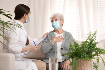 Nurse cares for assisted living patient in her home.