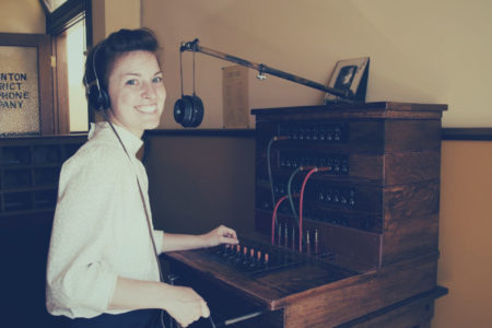 woman working at a medical answering telephone switchboard