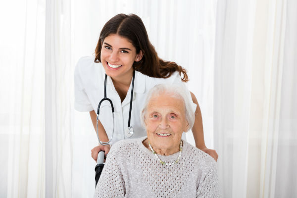 Homecare nurse with senior citizen patient in wheelchair